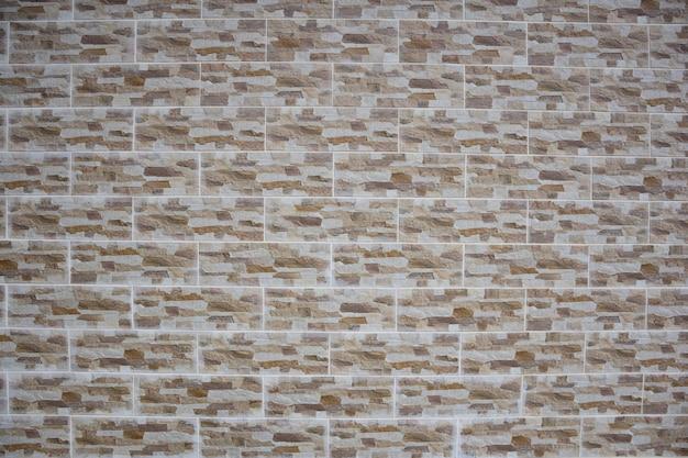 Такая же каменная тротуарная плитка выложена рядами в полный кадр