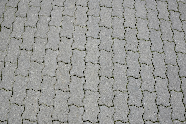 Same stone paving slabs laid out in rows in full frame