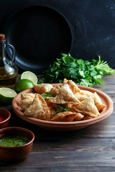 Samosa fried/baked pastry with savoury filling, popular indian snacks