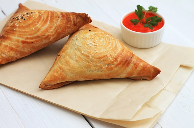 Samosa and sauce on white wooden, indian food.