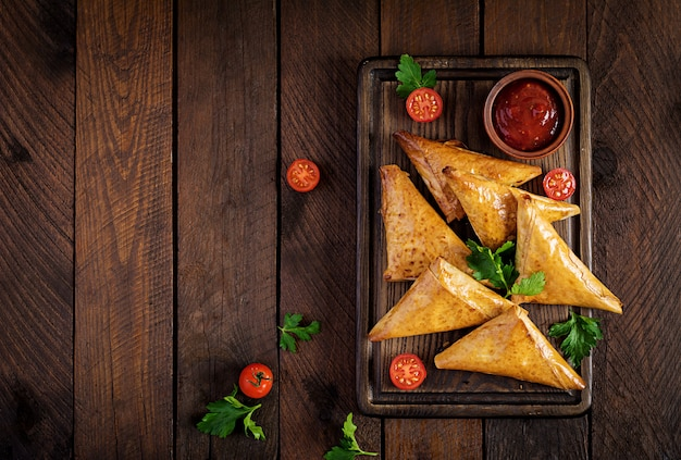 Samosas with chicken fillet and cheese