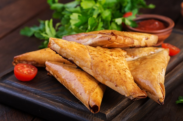 Samosas with chicken fillet and cheese.