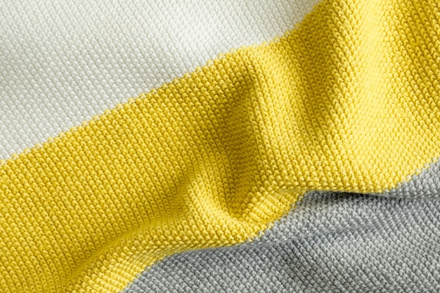 Sample of knitted fabric pattern trendy colors of the year 2021 illuminating, ultimate gray and white color.