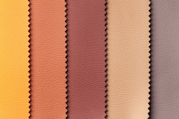 Sample of leather textile brown and red colors, background. catalog and swatch tone of interior fabric for furniture.