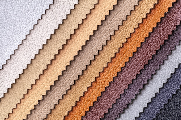 가죽 섬유 갈색과 회색 색상, 배경 샘플. 가구, 근접 촬영을위한 인테리어 패브릭의 카탈로그 및 팔레트 톤.