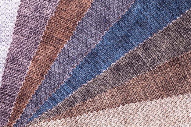 Sample of velvet textile brown and gray colors, background. catalog of interior fabric for furniture. velours multicolored cloth.