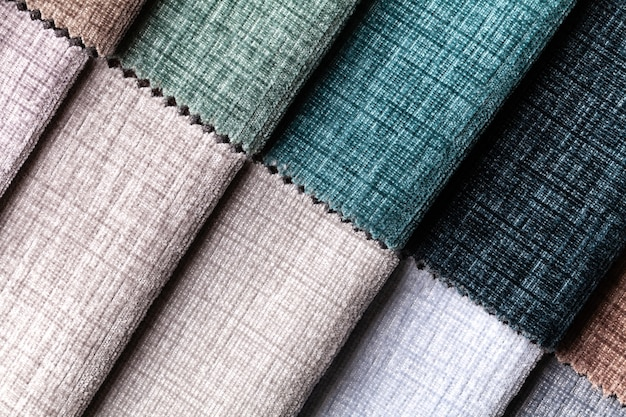 Sample of velvet and velours textile various colors, background. catalog and swatch of interior fabric for furniture. .
