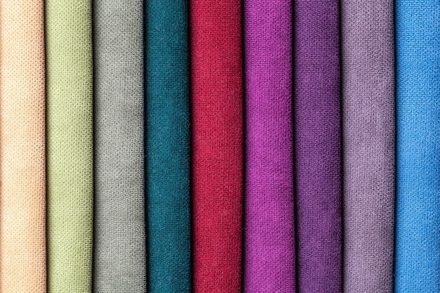 Sample of velvet and velours textile various colors, background