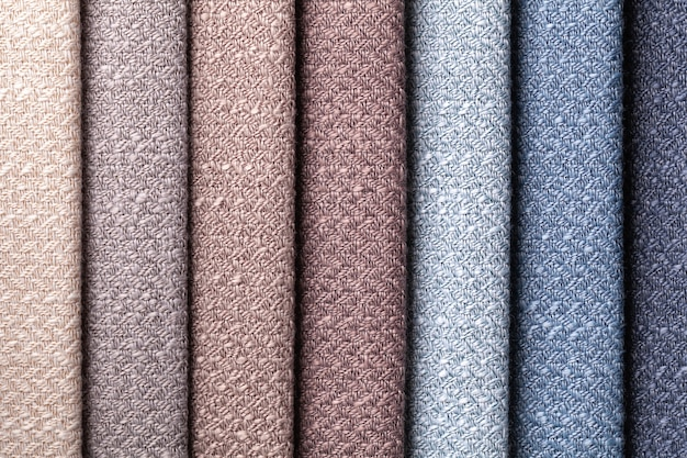 Sample of woven textile brown and gray colors, background. interior fabric for furniture, closeup.