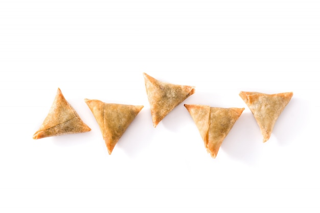 Samsa or samosas with meat and vegetables isolated on white, top view