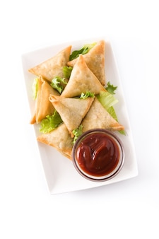 Samsa or samosas with meat and vegetables isolated on white. traditional indian food. top view.