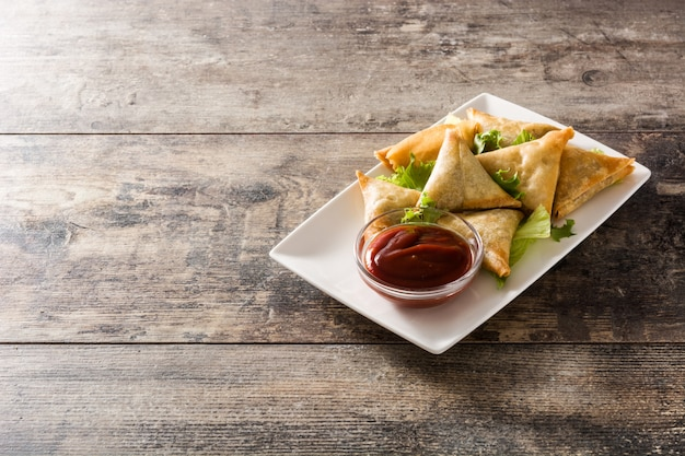 Samsa or samosas with meat and vegetables