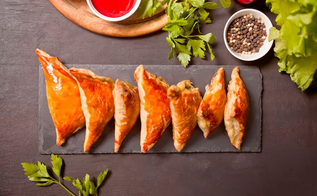Samsa with dipping sauces. delicious homemade samosas.
