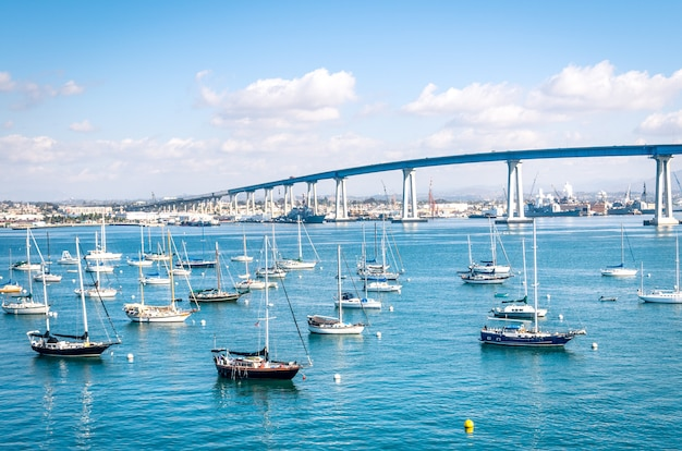 San diego waterfront with sailing boats - indutrial harbor and coronado bridge