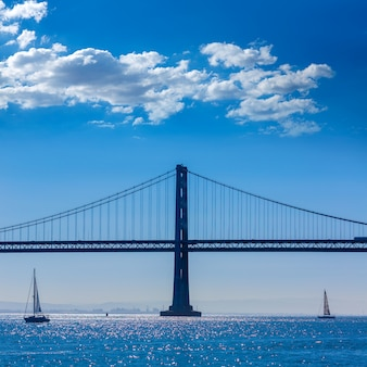 San francisco bay bridge sailboat from pier 7 california