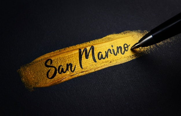 San marino handwriting text on golden paint brush stroke