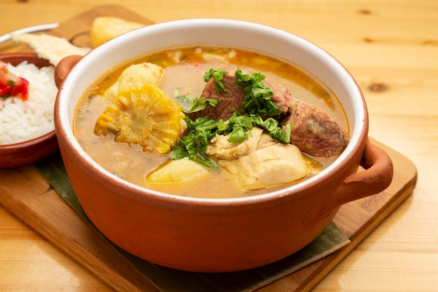 Sancocho is a traditional venezuelan and latin american soup or stew made with many types of beef, chicken with yuca plantain potato cassava and vegetables from the region