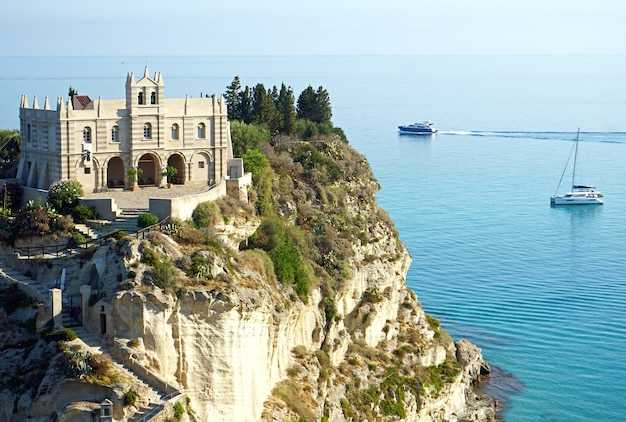 Sanctuary of santa maria dell isola on a cliff coast in tropea, calabria, italy