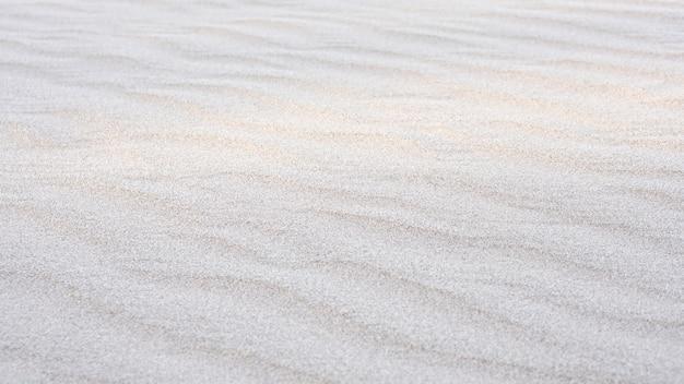 여름 시즌에 모래 해변 질감 배경