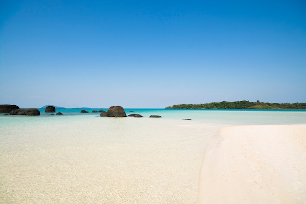 Sand beach with clear sea water and blue sky. island in gulf of thailand.