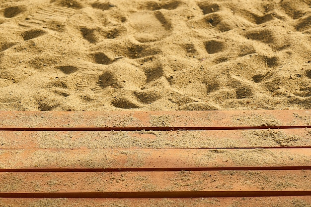 Sand beach with wooden boards
