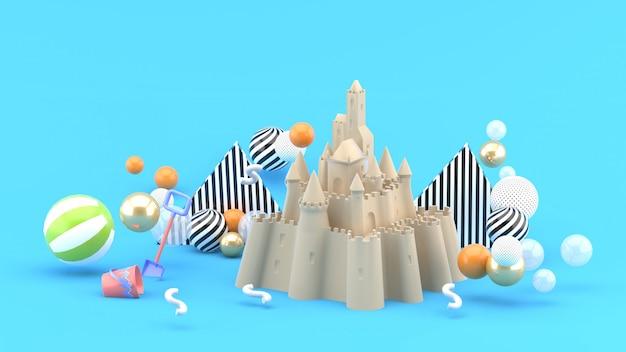 Sand castle amidst colorful balls on blue. 3d rendering.