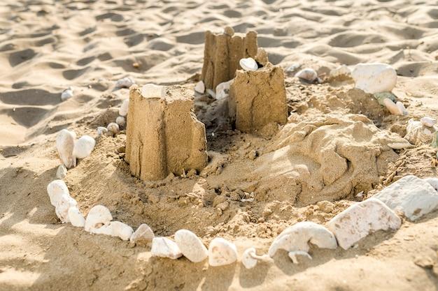 Sand castle on the ocean beach