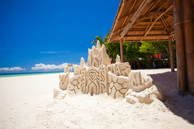 Sand castle on a white tropical sandy beach in boracay,philippines