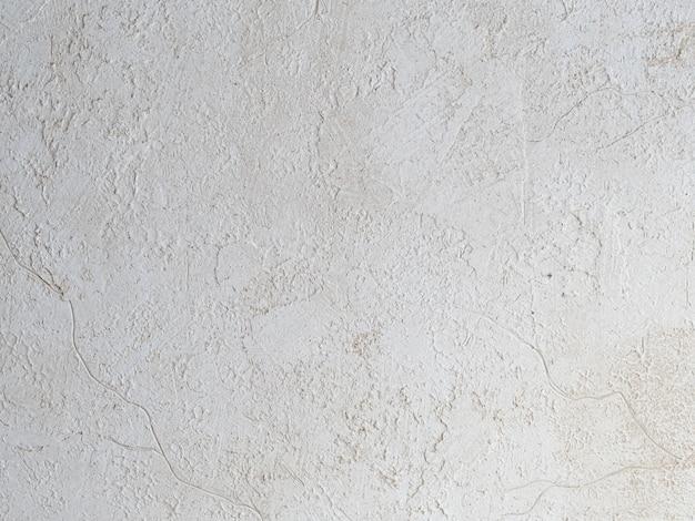 Песочного цвета окрашены текстуры с мазками кисти и мастихином для интересных и современных фонов. фото грубых штрихов коричневой бежевой краской. обои и копией пространства