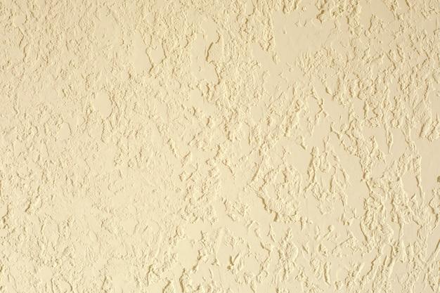 砂色の織り目加工の漆喰壁。商業施設の新鮮なオットヴェトカ、家のデザイナーの改修