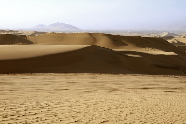The sand dune of huacachina desert in ica region, peru, south america