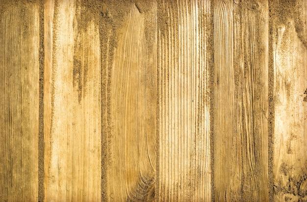 Песок на деревянной доске
