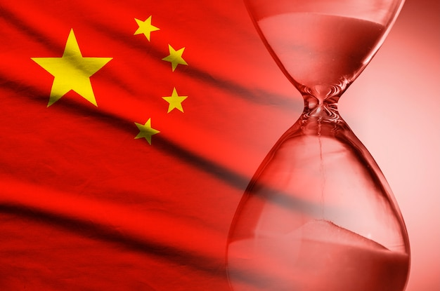 Sand running through an hourglass on flag of china