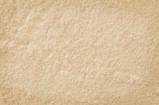 背景の高解像度で自然なパターンで砂の石造りの壁テクスチャ。