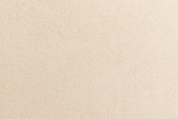 Fondo beige di struttura della superficie della sabbia zen e concetto di pace