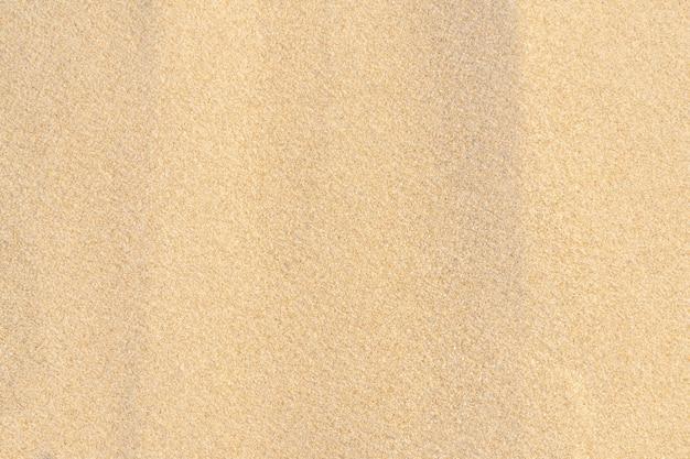 Sand texture background on the beach. light beige sea sand texture pattern, sandy beach background.