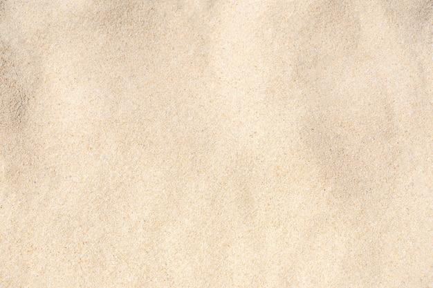 모래 질감 배경입니다. 열 대 해변에서 갈색 사막 패턴입니다. 확대.