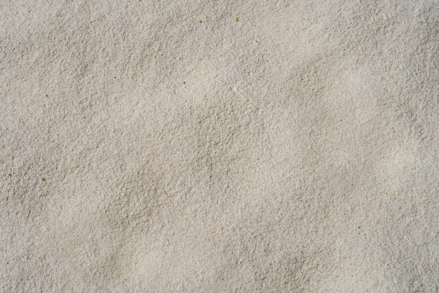 Sand texture background, natural sand at a soft white beach