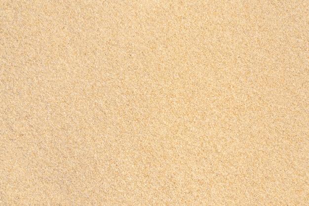 ビーチの砂のテクスチャの背景。明るいベージュの海砂のテクスチャパターン、砂浜の背景。