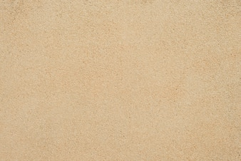 Sand Texture. Brown sand. Background from fine sand. Sand background.