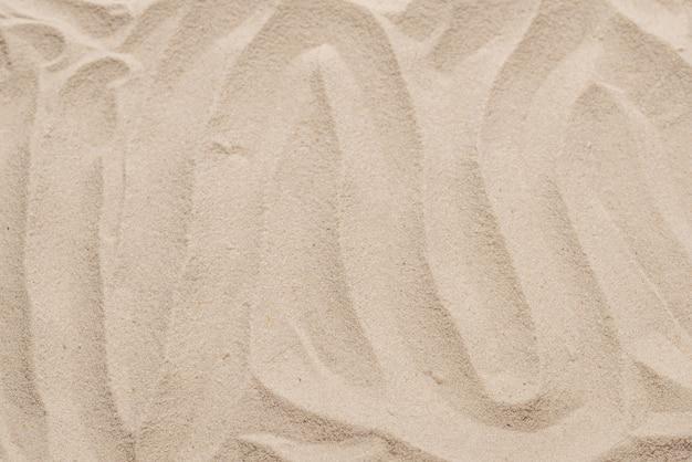 砂のテクスチャのクローズアップ。砂の背景。