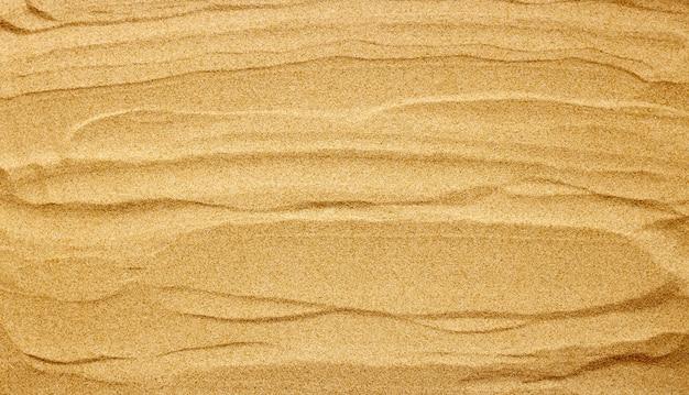 Текстура песка для фона. летний фон концепция