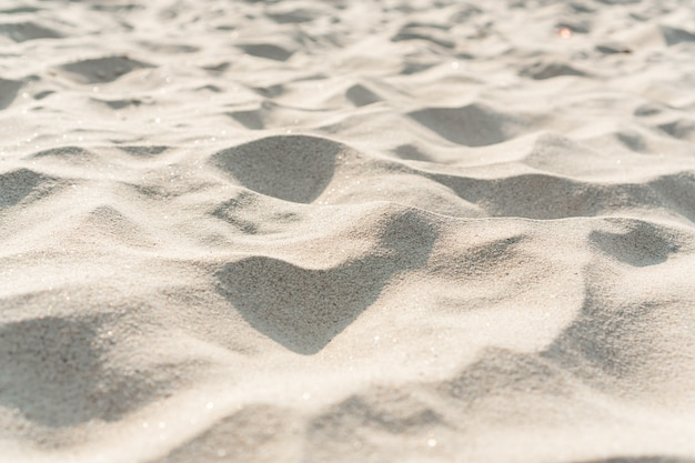 Sand texture. sandy beach for background. close up, copy space.