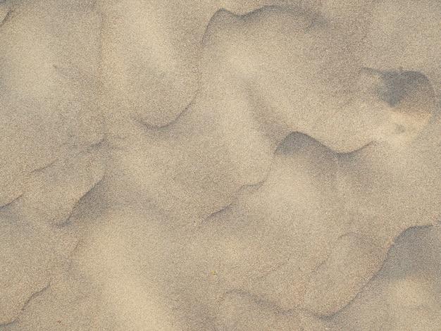 砂のテクスチャ。砂浜の背景。