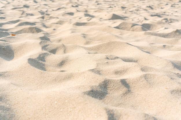 砂の質感。背景の砂浜。クローズアップ、スペースをコピーします。