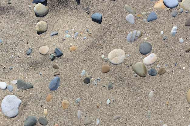Sand with sea pebbles. background for design. high quality photo