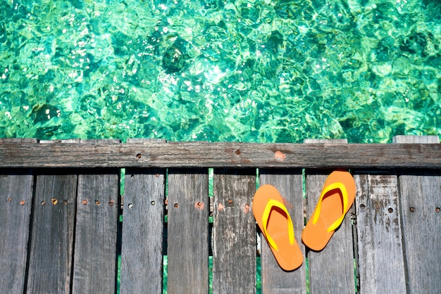 Sandals on the beautiful beach - summer vacation