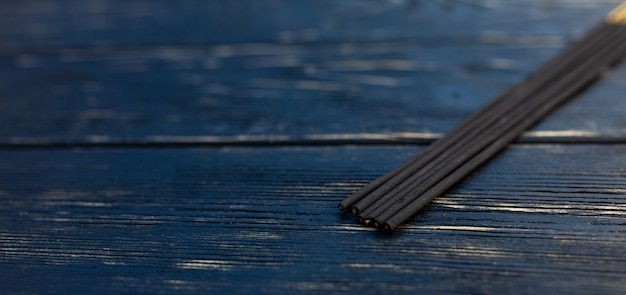 Sandalwood sticks on a black wooden table. traditional asian culture. aromatherapy