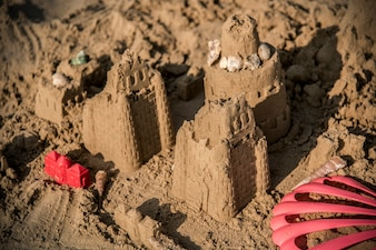 Sandcastle on a warm beach