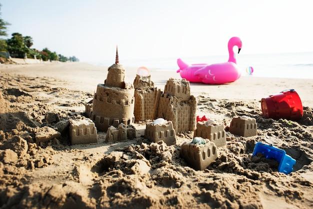 Sandcastle on a warm beach